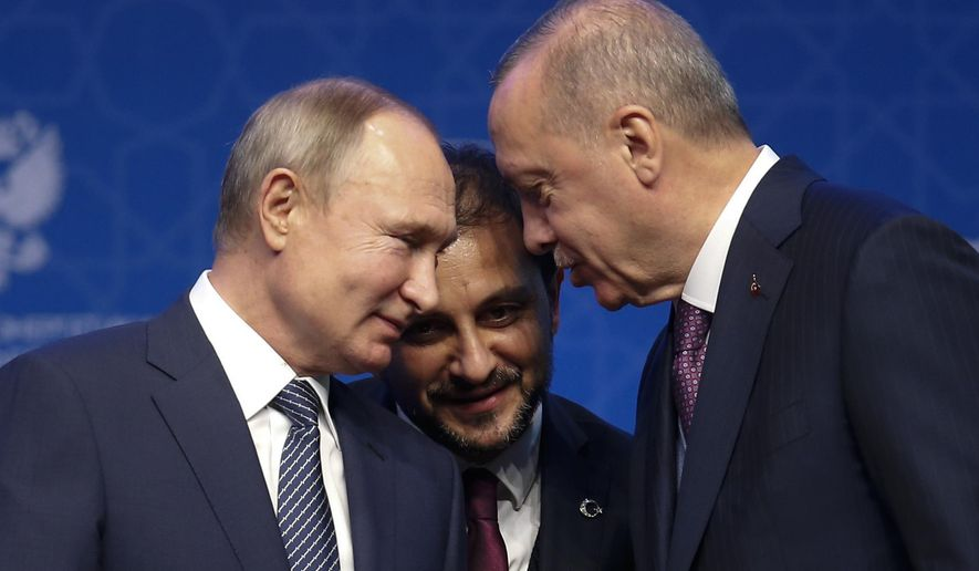 In this Jan. 8, 2020, file photo, Turkey's President Recep Tayyip Erdogan, right and Russia's President Vladimir Putin, left, talk during a ceremony in Istanbul for the inauguration of the TurkStream pipeline. A summit meeting between the Turkish and Russian leaders scheduled for Thursday, March 5, 2020, may be the last chance to work out a deal that avoids a calamity in Syria's northwest. (AP Photo/Lefteris Pitarakis, File)