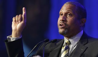 In this May 29, 2014 file photo, author and talk show host Tavis Smiley speaks at Book Expo America in New York.  A jury on Wednesday found that former talk show host Tavis Smiley violated the morals clause of his contract with the Public Broadcasting Service after allegations of workplace sexual misconduct, and must pay his former employer about $1.5 million. (AP Photo/Mark Lennihan, File)