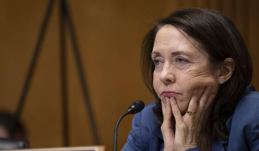 Sen. Maria Cantwell, D-Wash., is shown in this file photo in a Senate Finance Committee hearing on Capitol Hill in Washington, D.C., on Feb. 12, 2020. A staffer for Sen. Cantwell has tested positive for the novel coronavirus. (AP Photo/Alex Brandon) **FILE**