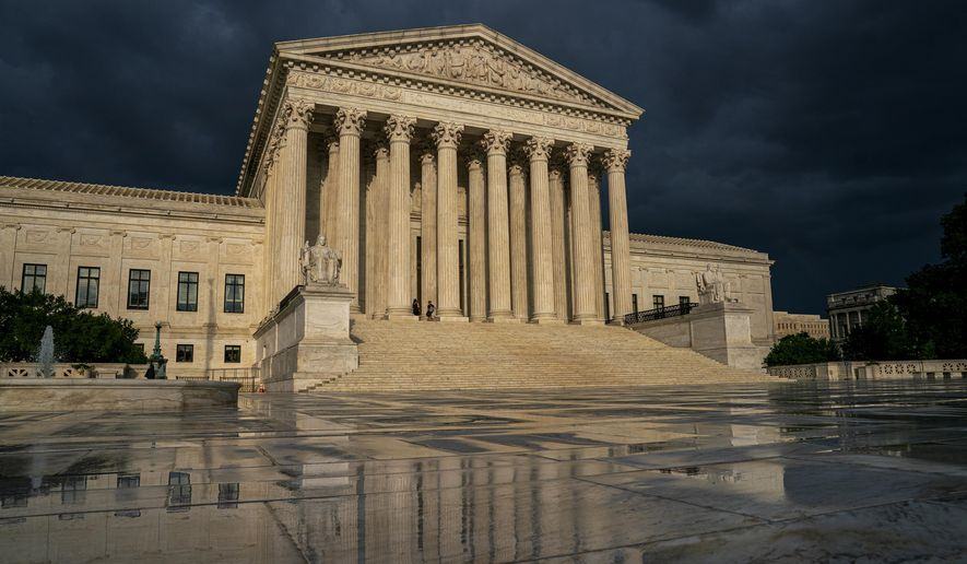In this June 20, 2019, file photo, the Supreme Court is seen under stormy skies in Washington. The Supreme Court is taking up the first major abortion case of the Trump era, an election-year look at a Louisiana dispute that could reveal how willing the more conservative court is to roll back abortion rights. (AP Photo/J. Scott Applewhite, File)