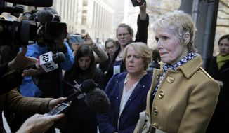 E. Jean Carroll, right, talks to reporters outside a courthouse in New York, Wednesday, March 4, 2020. As part of her defamation lawsuit against President Donald Trump, Carroll is seeking a DNA sample from him in an attempt to prove he raped her in the 1990s, which Trump denies.(AP Photo/Seth Wenig)