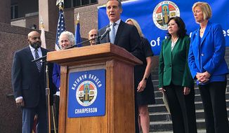 Los Angeles Mayor Eric Garcetti speaks at a news conference that announced that six new cases of the coronavirus have been confirmed in Los Angeles County, where there was one previously, on the steps of the county Hall of Administration in downtown Los Angeles Wednesday, March 4, 2020 The cases confirmed Tuesday night were due to a known exposure and not the result of so-called community transmission, Dr. Barbara Ferrer, director of the county Department of Public Health, said. One person was hospitalized and five others were in self-quarantine at home, she said. The cases were from throughout the county, she said, but did not give specific locations. (AP Photo/Stafanie Dazio)