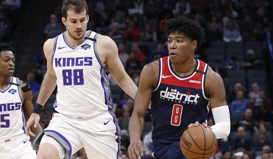 Washington Wizards forward Rui Hachimura, right, drives against Sacramento Kings forward Nemanja Bjelica during the first quarter of an NBA basketball game in Sacramento, Calif., Tuesday, March 3, 2020. (AP Photo/Rich Pedroncelli)