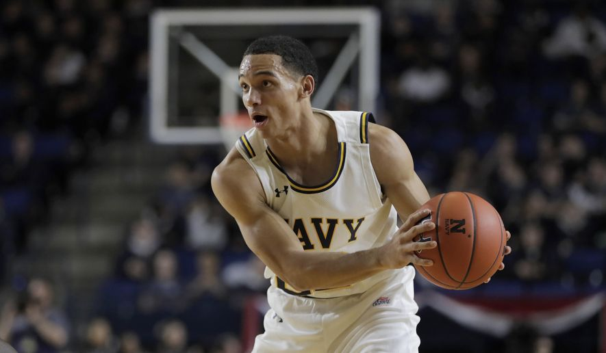 Navy guard Cam Davis scored 13 points to lead Navy in a 69-63 loss to Boston University in a Patriot League quarterfinal Thursday. (AP Photo/Julio Cortez) **FILE**