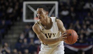 Navy guard Cam Davis scored 13 points to lead Navy in a 69-63 loss to Boston University in a Patriot League quarterfinal Thursday. (AP Photo/Julio Cortez) **FILE**