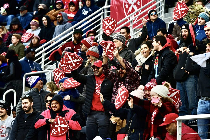 A group of football fans cheer for the DC Defenders of the XFL in the league's inaugural game between the Defenders and the Seattle Dragons at Audi Field in Washington, D.C., on Saturday, Feb. 8, 2020. (Photo by All-Pro Reels / Joe Glorioso)