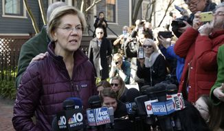 Sen. Elizabeth Warren, D-Mass., with her husband Bruce Mann's hand on her shoulder, speaks to the media outside her home, Thursday, March 5, 2020, in Cambridge, Mass., after she dropped out of the Democratic presidential race. (AP Photo/Steven Senne)