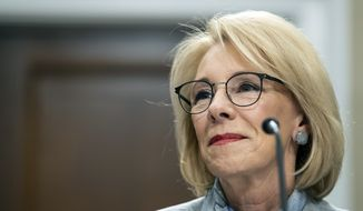 Education Secretary Betsy DeVos pauses as she testifies on Capitol Hill in Washington, during a hearing of the House Appropriations Sub-Committee on Labor, Health and Human Services, Education, and Related Agencies on the fiscal year 2021 budget. (AP Photo/Alex Brandon, File)