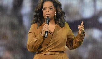 """This Feb. 8, 2020 file photo shows Oprah Winfrey speaking at """"Oprah's 2020 Vision: Your Life in Focus"""" tour in New York. (Photo by Brad Barket/Invision/AP, File)"""
