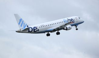 This Jan. 13, 2020, photo, shows a Flybe flight departing from Manchester Airport in London. The struggling British airline Flybe has collapsed, leaving passengers stranded and told to find their own way home. UK Civil Aviation Authority said in a statement Thursday, March 5, 2020, that financially troubled Flybe had entered administration. (Peter Byrne/PA via AP)