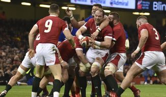 Wales Taulupe Faletau, centre, holds the ball during the Six Nations rugby union international between Wales and France at the Principality Stadium in Cardiff, Wales, Saturday, Feb. 22, 2020. (AP Photo/Rui Vieira)