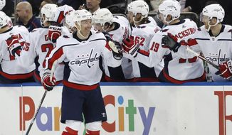 Washington Capitals left wing Ilya Kovalchuk (17) receives congratulations after he scored a goal during the second period of the team's NHL hockey game against the New York Rangers, Thursday, March 5, 2020, in New York. (AP Photo/Kathy Willens)