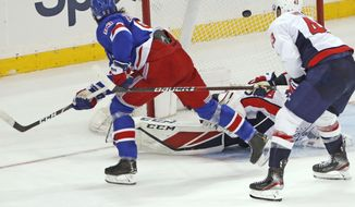 New York Rangers center Mika Zibanejad, upper left, scores in overtime against Washington Capitals goaltender Ilya Samsonov as Capitals right wing Tom Wilson (43) defends during an NHL hockey game Thursday, March 5, 2020, in New York. Zibanejad had five goals as the Rangers won 6-5. (AP Photo/Kathy Willens)