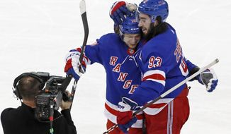 New York Rangers left wing Artemi Panarin and center Mika Zibanejad (93) celebrate after Zibanejad scored in overtime of the team's NHL hockey game against the Washington Capitals, Thursday, March 5, 2020, in New York. The Rangers defeated the Capitals 6-5 in overtime; Zibanejad scored five goals. (AP Photo/Kathy Willens)