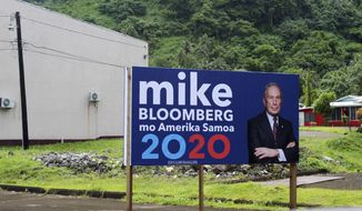 In this Feb. 27, 2020 photo, a sign for the Mike Bloomberg campaign is shown in the village of Nu'uuli, near Pago Pago, American Samoa. Mike Bloomberg spent more than $500 million to net one presidential primary win in the U.S. territory of American Samoa. His lone victory in the group of islands with a population of 55,000 was an unorthodox end to his much-hyped but short-lived campaign that ended Wednesday, March 4. (AP Photo/Fili Sagapolutele)