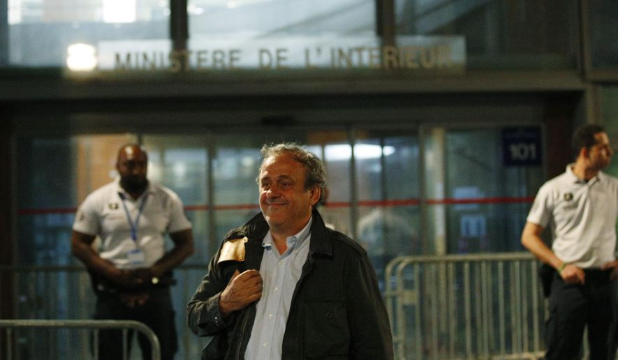FILE - In this file photo dated Wednesday, June 19, 2019, Michel Platini leaves the French police anti-corruption and financial crimes office in Nanterre, outside Paris. Platini has lost his appeal at the European Court of Human Rights to overturn a four-year ban from soccer for financial wrongdoing taking a dollars 2 million payment from FIFA, according to a unanimous ruling published Thursday March 5, 2020, by the court in Strasbourg, France. (AP Photo/ Francois Mori, FILE)