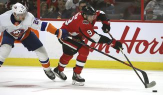 Ottawa Senators right wing Bobby Ryan (9) and New York Islanders defenseman Scott Mayfield (24) vie for the puck during second period NHL hockey action in Ottawa on Thursday, March 5, 2020. (Fred Chartrand/The Canadian Press via AP)