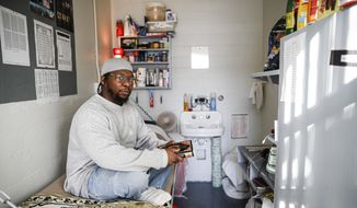 In this Thursday, Feb. 13, 2020, file photo, Myon Burrell sits inside his cell at the Minnesota Correctional Facility in Stillwater. On Thursday, March 5, 2020, Sen. Amy Klobuchar, D-Minn., called for an independent probe of the murder case she prosecuted that sent a teenage Burrell to prison for life. (AP Photo/John Minchillo)