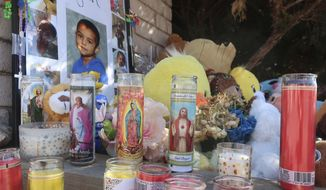 A memorial for a 6-year-old boy in Flagstaff, Arizona, grows on Wednesday, March 4, 2020, as residents add stuffed animals, balloons, candles and messages for the child. Police have arrested the boy's parents and grandmother on suspicion of murder and child abuse in the boy's death. (AP Photo/Felicia Fonseca)