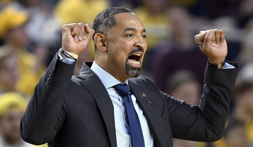 Michigan coach Juwan Howard calls in a play to the team as it played against Nebraska during the first half of an NCAA college basketball game Thursday, March 5, 2020, in Ann Arbor, Mich. (AP Photo/Jose Juarez)