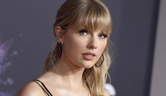 This Nov. 24, 2019, file photo shows Taylor Swift at the American Music Awards in Los Angeles. A spokesperson for  Swift confirms the pop star is donating $1 million to tornado relief efforts in Middle Tennessee. (Photo by Jordan Strauss/Invision/AP, File)