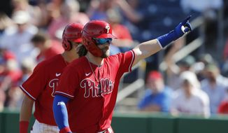 Philadelphia Phillies' Bryce Harper waves to fans after his two-run home run during the fourth inning of a spring training baseball game against the Pittsburgh Pirates, Wednesday, March 4, 2020, in Clearwater, Fla. (AP Photo/Carlos Osorio) **FILE**