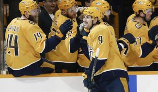 Nashville Predators left wing Filip Forsberg (9), of Sweden, is congratulated after scoring against the Dallas Stars in the first period of an NHL hockey game Thursday, March 5, 2020, in Nashville, Tenn. (AP Photo/Mark Humphrey)