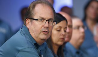 FILE - In this July 16, 2019, file photo, Gary Jones, United Auto Workers President, speaks during the opening of their contract talks with Fiat Chrysler Automobiles in Auburn Hills, Mich. Federal prosecutors have charged the former president of the United Auto Workers with corruption, Thursday, March 5, 2020,  alleging he conspired with others at the union to embezzle more than $1 million.   Jones quit his post in November 2019. (AP Photo/Paul Sancya, File)