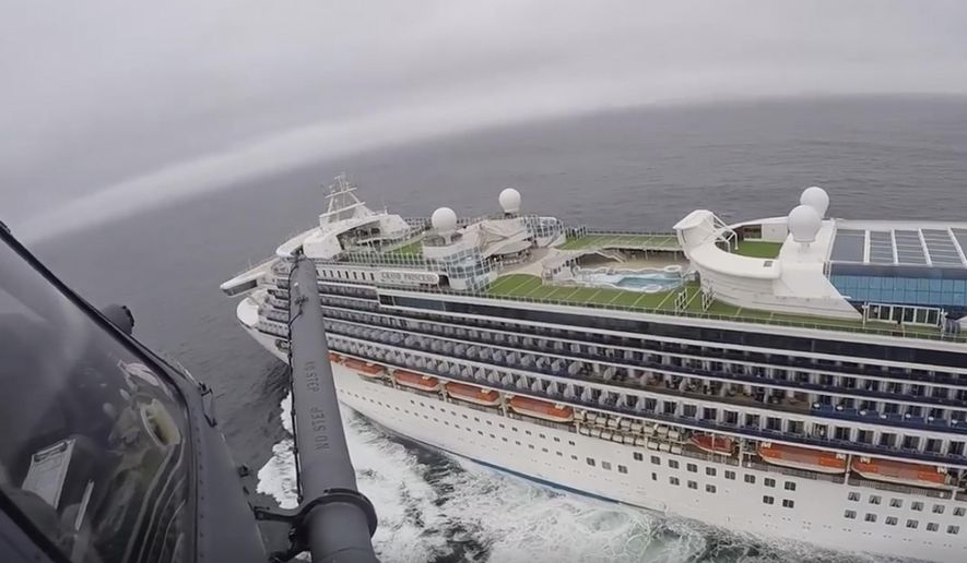 In this image from video, provided by the California National Guard, a helicopter carrying airmen with the 129th Rescue Wing flies over the Grand Princess cruise ship off the coast of California Thursday, March 5, 2020. Scrambling to keep the coronavirus at bay, officials ordered a cruise ship with 3,500 people aboard to stay back from the California coast Thursday until passengers and crew can be tested, after a traveler from its previous voyage died of the disease and at least two others became infected. Airmen lowered test kits onto the 951-foot (290-meter) Grand Princess by rope as the vessel lay at anchor off Northern California, and authorities said the results would be available on Friday. Princess Cruise Lines said fewer than 100 people aboard had been identified for testing. (California National Guard via AP)