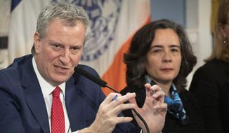 In this Wednesday, Feb. 26, 2020, file photo, Mayor Bill de Blasio, left, with Dr. Oxiris Barbot, commissioner of the New York City Department of Health and Mental Hygiene, reports on the city's preparedness for the potential spread of the coronavirus in New York. (AP Photo/Mark Lennihan, File)