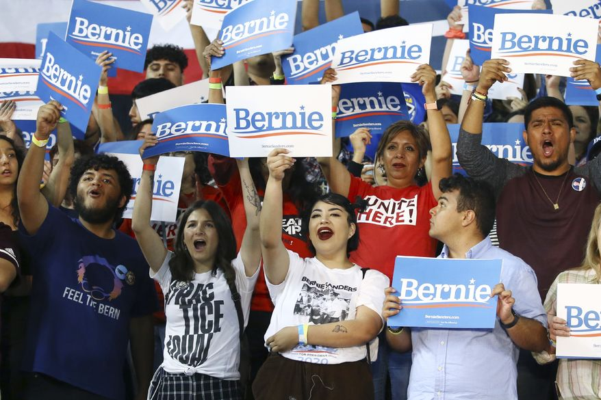 Supporters of Democratic presidential candidate Sen. Bernie Sanders, I-Vt., cheer for the candidate during a campaign rally Thursday, March 5, 2020, in Phoenix. (AP Photo/Ross D. Franklin) ** FILE **