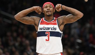 Washington Wizards guard Bradley Beal (3) gestures during the second half of an NBA basketball game against the Atlanta Hawks, Friday, March 6, 2020, in Washington. (AP Photo/Nick Wass)