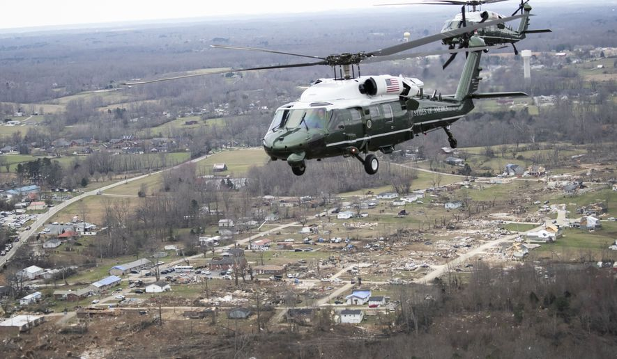 Marine One, with President Donald Trump aboard, left, flies over damage after a recent tornado, Friday, March 6, 2020, taken on the plane in flight over Cookeville, Tenn. (AP Photo/Alex Brandon)