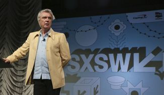 "In this March 13, 2019, file photo, David Byrne takes part in the ""Reasons To Be Cheerful"" featured session during the South by Southwest Music Festival in Austin, Texas. Austin city officials have canceled the South by Southwest arts and technology festival. Mayor Steve Adler announced a local emergency that effectively canceled the annual event. (Photo by Jack Plunkett/Invision/AP, File) ** FILE **"