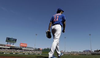 Chicago Cubs starting pitcher Yu Darvish takes the field to start a spring training baseball game against the Milwaukee Brewers, Saturday, Feb. 29, 2020, in Mesa, Ariz. (AP Photo/Gregory Bull)