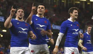 France players celebrate after the Six Nations rugby union international between Wales and France at the Principality Stadium in Cardiff, Wales, Saturday, Feb. 22, 2020. (AP Photo/Rui Vieira)