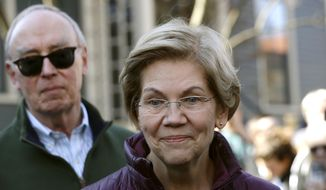 Sen. Elizabeth Warren, D-Mass., speaks outside her home beside her husband Bruce Mann, Thursday, March 5, 2020, in Cambridge, Mass., after she dropped out of the Democratic presidential race. (AP Photo/Steven Senne) **FILE**