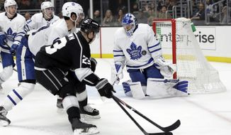 Toronto Maple Leafs goaltender Frederik Andersen, right, stops a shot against the Los Angeles Kings during the second period of an NHL hockey game Thursday, March 5, 2020, in Los Angeles. (AP Photo/Marcio Jose Sanchez)