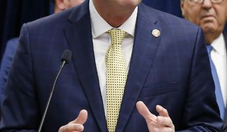 In this Nov. 1, 2019 file photo Oklahoma Gov. Kevin Stitt speaks at a news conference in Oklahoma City. Gov. Stitt's administration is submitting a proposal to expand Medicaid to the federal government, but Republican lawmakers who oppose expansion are balking at a plan to pay for the state's share. (AP Photo/Sue Ogrocki, File)