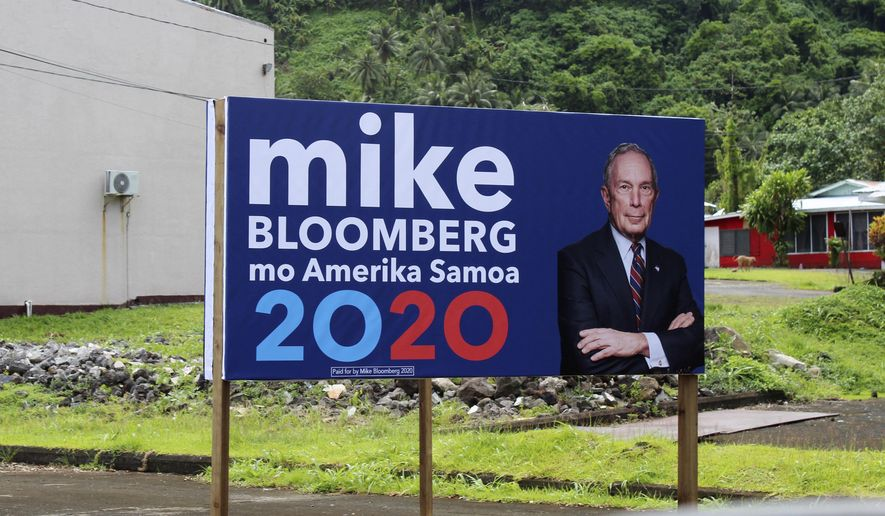 FILE - In this Feb. 27, 2020 photo, a sign for the Mike Bloomberg campaign stands in the village of Nu'uuli, near Pago Pago, American Samoa. On Friday, March 6, 2020, The Associated Press reported on stories circulating online incorrectly asserting that instead of spending $500 million on ads for his 2020 Democratic presidential campaign, he could have used that amount to give each American $1 million and still have money left over. The U.S. population is 327 million, which would come out to $1.53 for each resident. (AP Photo/Fili Sagapolutele)