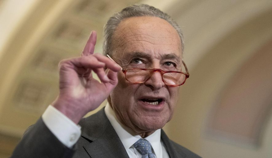 """In this Tuesday, March 3, 2020 file photo, Senate Minority Leader Chuck Schumer of N.Y., speaks about the coronavirus during a media availability on Capitol Hill in Washington. On Friday, March 6, 2020, The Associated Press reported on stories circulating online incorrectly asserting that Schumer deleted a tweet saying President Trump's travel ban to China is """"an excuse to further his ongoing war against immigrants."""" The tweet, made to appear it came from Schumer's verified account, was fabricated. A screen capture of Schumer's Twitter page from Feb. 5 on the Wayback Machine, an internet archive, shows no such tweet. (AP Photo/Alex Brandon)"""