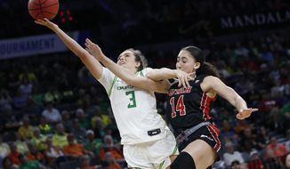 Utah's Niyah Becker (14) fouls Oregon's Taylor Chavez (3) during the second half of an NCAA college basketball game in the quarterfinal round of the Pac-12 women's tournament Friday, March 6, 2020, in Las Vegas. (AP Photo/John Locher)