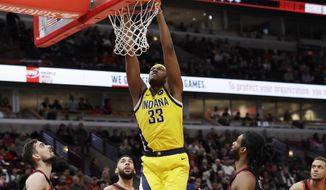 Indiana Pacers' Myles Turner (33) dunks against the Chicago Bulls during the first half of an NBA basketball game in Chicago, Friday, March 6, 2020. (AP Photo/Nam Y. Huh)