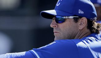 Kansas City Royals manager Mike Matheny watches from the dugout during the second inning of a spring training baseball game against the San Diego Padres Monday, Feb. 24, 2020, in Surprise, Ariz. (AP Photo/Charlie Riedel)