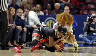 Georgia's Maya Caldwell, left, and South Carolina's Brea Beal battle for a loose ball during a quarterfinal match at the Southeastern women's NCAA college basketball tournament in Greenville, S.C., Friday, March 6, 2020. (AP Photo/Richard Shiro)