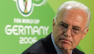 FILE - In this June 29, 2006 file photo Franz Beckenbauer, then President of the German Organization Committee of the soccer World Cup briefs the media during a news conference at the Olympic Stadium in Berlin. Five years into a sprawling investigation of soccer corruption, the first courtroom trial in Switzerland is due to begin Monday, March 9, 2020 in a 2006 World Cup fraud case. Sepp Blatter, the former FIFA president, and German soccer great Franz Beckenbauer are listed by Switzerland's federal criminal court to testify in the trial of four soccer officials implicated in a suspect 6.7 million euros ($7.6 million) payment. (AP Photo/Markus Schreiber, file )