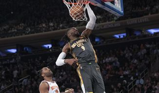 Oklahoma City Thunder center Nerlens Noel (9) dunks past New York Knicks guard Wayne Ellington (2) during the first half of an NBA basketball game Friday, March 6, 2020, at Madison Square Garden in New York. (AP Photo/Mary Altaffer)