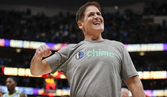 Dallas Mavericks owner Mark Cuban celebrates the team's 120-112 win over the Portland Trail Blazers in an NBA basketball game Friday, Jan. 17, 2020, in Dallas. (AP Photo/Brandon Wade)