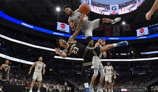 Villanova forward Jermaine Samuels (23) falls after he was fouled by Georgetown guard Jagan Mosely (4) during the second half of an NCAA college basketball game, Saturday, March 7, 2020, in Washington. Villanova won 70-69. (AP Photo/Nick Wass)
