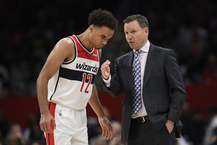 Washington Wizards head coach Scott Brooks talks with guard Jerome Robinson (12) during the second half of an NBA basketball game against the Atlanta Hawks, Friday, March 6, 2020, in Washington. The Wizards won 118-112. (AP Photo/Nick Wass) **FILE**